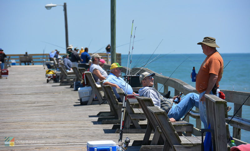 Relaxing and fishing with a cool beverage on Avalon fishing pier