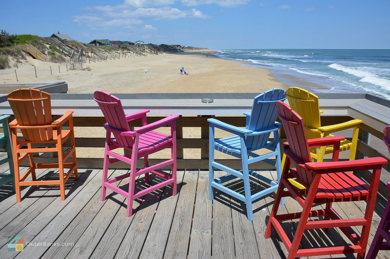 Colorful chairs look over the beach at Avalon Pier