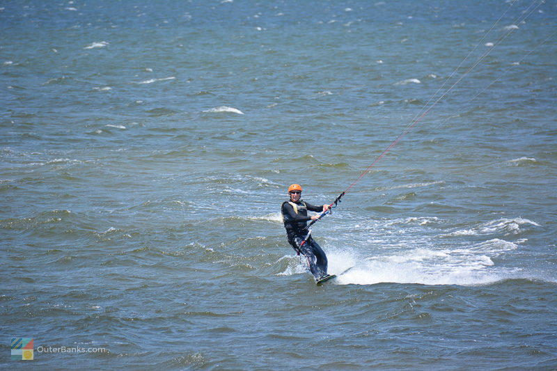 A kiteboarder in Waves
