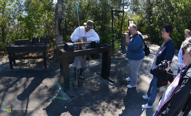 An interpreter recreates settlment life at Roanoke Island Festival Park