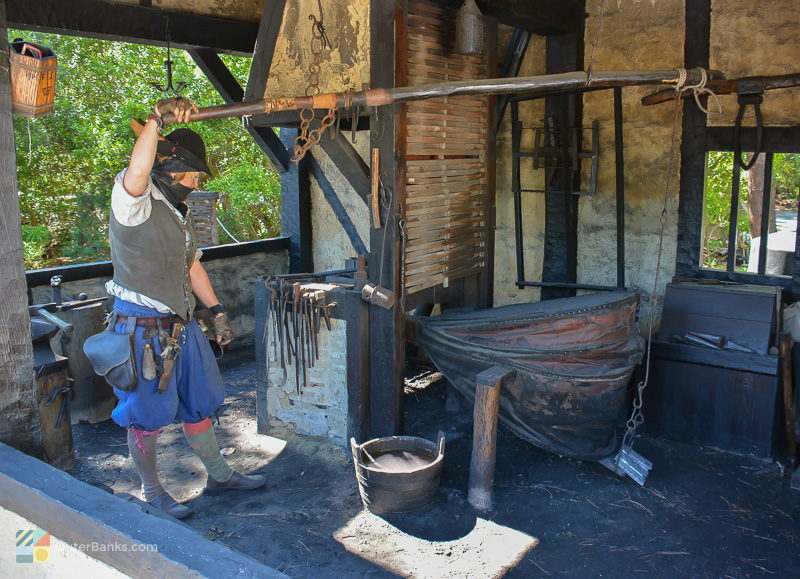 An interpreter uses original methods to create iron tools and nails at Roanoke Island Festival Park