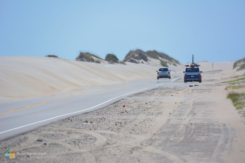 Man-made dunes line NC 12 through the tri-villages of Rodanthe, Waves and Salvo