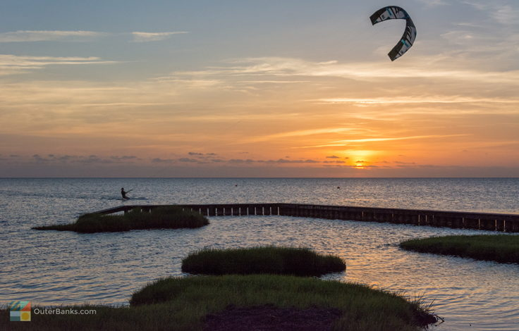 Kiteboarding at sunset in Waves
