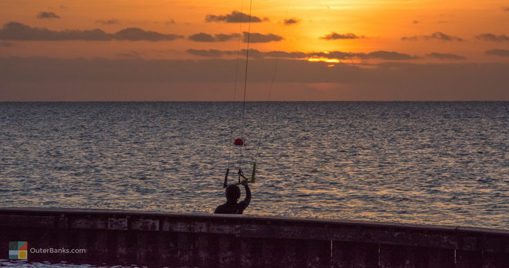 Kiteboarder watching the sunset over Pamlico Sound