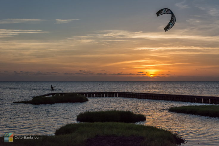 Kiteboarding in Waves at sunset