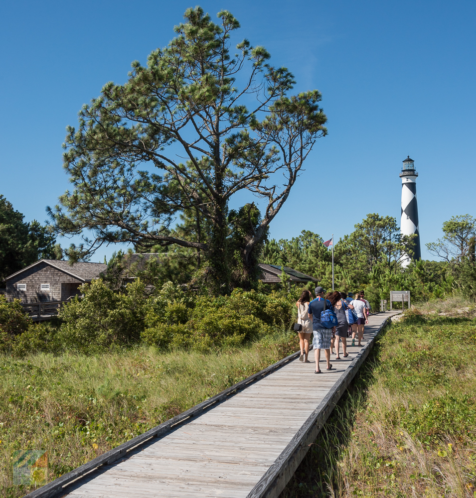 Visitors walk toward the Cape Lookout Lighthouse